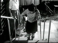 Stair climbing in polio rehab (jackcast2015) Tags: handicapped disabledwoman crippledwoman wheelchair paralysed poliogirl legbraces calipers polio