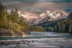 (Margarita Genkova) Tags: ice snow clouds trees river rocks nature pristine bowfalls banffnationalpark alberta rockymountains winter