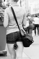 Woman Holding Tripod (David Allan Barker) Tags: city urban woman toronto photography blackwhite photographer tripod streetphotography dundassquare