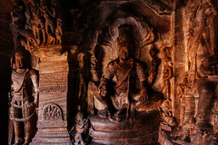 Lord Vishnu seated on a serpent in one of the cave shrines of Badami (Madhu Gopalan) Tags: travel india cave karnataka badami chalukya rockcut
