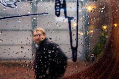 Peak (Hutchography.com) Tags: street toronto ontario canada man window glass look rain walking 22 blurred mysterious raindrops