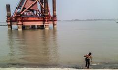bath in padma (سلطان محمود) Tags: man bridge padma river mighty bathing water sky pillar