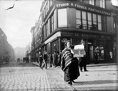 Woman with birdcage at junction of Grafton Street and South King Street (National Library of Ireland on The Commons) Tags: dublin graftonstreet monypeny birdcage southkingstreet cobbles forbes jjclarke brianpclarke–donor nationallibraryofireland johnjosephclarke clarkephotographiccollection gaietytheatre mercerlibrary knitting shawl dublinmetropolitanpolice dmp horseshoebar patons studio