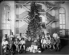 Christmas in Jail, 1919. (District of Columbia) (melystu) Tags: men group workers bakers dc jail tree christmas convicts inmates africanamerican prisoners america flags holiday formal symbolic wwi history loc libraryofcongress incarcerated architecture prison arch windows chandelier stairs christmastree historic electricity food baskets gifts