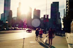 sunny strollers (KevinIrvineChi) Tags: bokeh strollers walking pedestrians street sidewalk outdoors outside outdoor sony dscrx100 buildings skyscrapers chicago chicagoist women no parking sign americanflag sunspots car cars lateafternoon sun sunny lakeshore east illinois unfocused giacometti