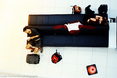 waiting for plane (lashtsertsvadze) Tags: travel friends red people urban rome roma travelling film dogs colors composition reading book florence airport nikon women waiting colours kodak outdoor sleep budapest streetphotography firenze resting fleamarket filmphotography nikonfg 50mmlens 28mmlens