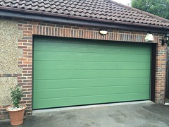 Any one for a green specially sprayed sectional door?