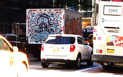 truck rear and context (simply innocuous) Tags: nyc orange fish art truck graffiti folkart grafitti manhattan vehicle whale spraypaint urbanimal