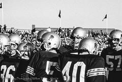 In The Huddle (uselessbay) Tags: blackandwhite film sports canon football f1 1978 brownuniversity ilfordfp4plus125 uselessbay canonf1 epsonperfectionv600 uselessbayphotography williamtalley dxofilmpack5
