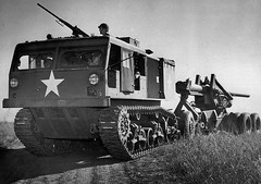 A US M4 High Speed Tractor towing a M1 Long Tom 155mm Gun.