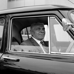 The Driver (ted.kozak) Tags: portrait blackandwhite bw 120 6x6 monochrome car vintage mediumformat square oldman retro suit driver rodinal volga dapper selfdeveloped kozak bronicasqa gaz21 zenzanonps80mmf28 tedkozak tadaskazakevicius wwwtedkozakcom
