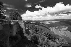From the Castle Walls (Dominique Knobben) Tags: travel trees sky white black castle monochrome clouds river germany landscape grey view elbe