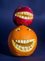 Piggyback (munkehmans) Tags: apple citrus citrusfruit color colorful eye eyes fruit funny humerous humour juicy orange pith red redapple rind segment skin smile smiley teeth