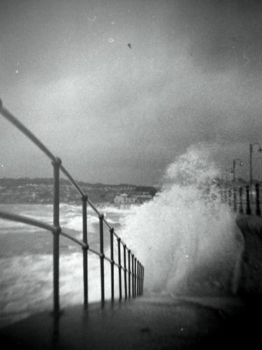 storm sea water fence slip penzance cornwall