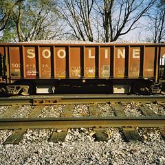 Railroad (orangedot777) Tags: hoppercar sooline freightcar kodakfilm ricohr1 traintracks railroadtracks sansserif