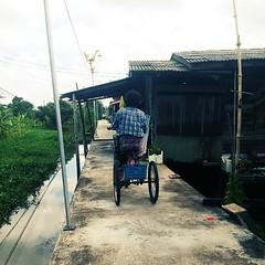 Grandma riding on her tricycle around Ko Kret island (shazell212) Tags: travel square thailand bangkok tricycle transport squareformat oldlady everydaylife peoplewatching kokret livinglife iphoneography instagramapp uploaded:by=instagram everydayasia