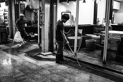 Kyoto_Shop_Clean up at end of day (Vincent Albanese) Tags: life street light people bw woman sunlight man bike japan shop dark walking photography japanese fuji shadows candid transport sydney inspired streetphotography saturday australia pedestrian smoking explore adobe biking fujifilm midday learn shopfront brilliance lightroom amatuer shopkeeper allpeople presets 23mm mirrorless xpro1 inspiredeye lightroom5 xf23mm x100s xf27mm elephantgunpreset