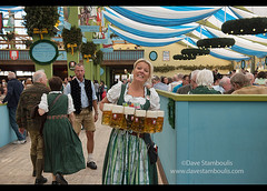 Waitress carrying masses of beer at Oktoberfest in Munich, Germany (jitenshaman) Tags: travel party beer festival germany munich münchen bavaria mas europe drinking oktoberfest alcohol mug destination munchen waitress heavy brew stein bavarian dirndl hofbräu worldlocations massweight