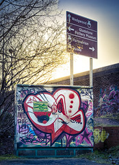 Behind the Signs (archie.logical) Tags: canal trentandmerseycanal hdr a500 thepotteries roadsign graffiti stokeontrent sunset