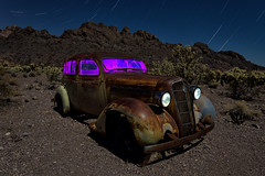plymouth amongst the cholla. eldorado canyon, nv. 2016. (eyetwist) Tags: eyetwistkevinballuff eyetwist night 1935 plymouth sedan purple rusty techatticupmine eldoradocanyon nelson nevada abandoned ruins dark longexposure long exposure fullmoon desert nikon d7000 nikkor capturenx2 1024mmf3545g npy nocturne highdesert americana americantypology american typology dead desolate lonely derelict decay nv wideangle 1024mm shadow mojavedesert ruin lightpainting old vintage rust southwest startrails star trails techatticup mine typography ghosttown touristtrap coloradoriver grille hood patina chrome carmageddon car auto gasoline cactus cholla headlights dented