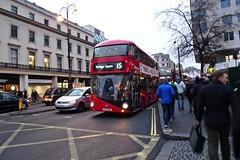P1090865  Trafalgar Square route 1§5 (smith.rodney74) Tags: ltz1404 itsu starbuckscoffee redbus manwithabag barebranches busybusy yellowbox crappicture lightson balastrade