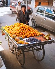 Today's Oranges (Fortunes2011.) Tags: fortunes2011 street streetphotography streetportrait portrait candid orange oranges food fruit fruites fresh cart wheels kiosk seller car vendor