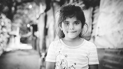 girl in the street (Jon and Rach | Photography) Tags: jon rach photography girl elsalvador salvadorian child street elrosario portrait impromptu bw blackwhite happy smile bokeh sony alpha a850 sonya850 alpha850 minolta 28105mm classicglass rural alphamount amount road travel