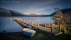 St Mary's Loch (.Brian Kerr Photography.) Tags: scottishborders scottishlandscapes scotland scotspirit visitscotland dgwgo dumfriesandgalloway stmarysloch jetty snow winter weather availablelight light cold coldmorning boat naturallandscape nature sunlight morning freezing reflections tree shadows lighting clouds sky longexposure wintery