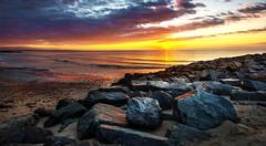 sunrise (Richard Lynam) Tags: wexford coast beach rosslare rocks landscapes seascape colours sea sun sunrise ireland