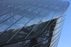 Angle window (ocaylus) Tags: blue sky cloud france reflection building art glass architecture mirror louis europe skies image steel bleu reflet ciel reflect nuage reflexion vuitton mirroir fondation