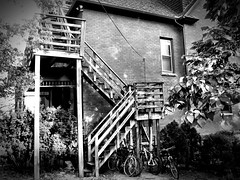 Climbers & Riders (Dennis Sparks) Tags: stairs blackwhite apartments michigan annarbor bikes