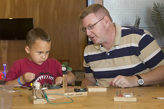 A making duo learns about conductivity in MAKESHOP during Maker Faire Pittsburgh.
