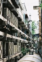 Siam Square - Bangkok (jcbkk1956) Tags: building film analog 35mm thailand nikon bangkok pipes manual nikkor siamsquare vents airconditioning f301 85mmf18 fujicolour viagginelmondo worldtrekker