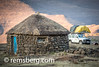 Land Rover parked with a tent set up behind a hut in a village in Lesotho, Africa (Remsberg Photos) Tags: africa travel camping sunset usa outdoors village tent wanderlust adventure explore hut transportation landrover lesotho defender thatchroof stonematerial