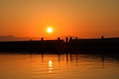 in the sunset... (JoannaRB2009) Tags: sunset orange yellow landscape seascape water reflections nature silhouettes sun people chania xania hania canea harbour crete kriti kreta greece