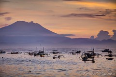 Between Clouds And A Dream (Brian O'Mahony) Tags: orange waves sunrise seascape bali clouds mountain sky beach sea horizon canon5dmarkii canon brianomahony boats thephotographiceye canon70200mmf28l shore mount agung sanur indonesia water volcano landscape