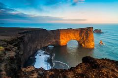 Golden Sea Cave - Iceland, Dyrholaey (Nomadic Vision Photography) Tags: travel sunset summer lava iceland europe scenic vik peninsula volcanic seacave dyrholaey jonreid tinareid nomadicvisioncom