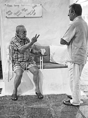 Due (p$ychoboyJ@ck) Tags: old 2 two bw man bar greek funny chat lounge streetphotography bn greece grecia talking chatting due rodi anziano sitted chiaccherare
