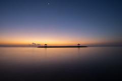 Peace (Thanwan Singh) Tags: morning blue light sea bali orange cloud beach water yellow sunrise indonesia dawn peace purple wind horizon hut serenity relaxation skyblue sanur pantaisanur pantaikarang