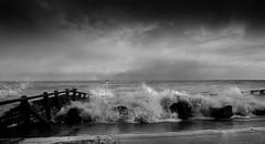 The Wave (Susie Potter) Tags: sea sky blackandwhite clouds rocks wave aldeburgh groynes