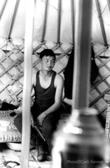 Naiman Nuur/2 (Cath Forrest) Tags: blackandwhite man indoors mongolia poles vest tongs thermos ger latticework mongolians orkhon herders orkhonvalley