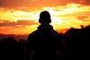 Silueta (Japo García) Tags: silueta tramonto atardecer fuego rojo naranjas cielo nubes chico uno gorra contraluz bosque meditación contemplar fotografía centrado joven horizontal nikon japo garcía foto