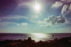 Morning Walking (hiphopmilk) Tags: nikonfm2n nikonfm2 nikon fm2 35mm 135film film analog analogue kodak nikkor jaredyeh hiphopmilk taiwan lanyu orchid island pongso no tao 蘭嶼 yami ivalino sun sunshine sunrise sky clouds sea ocean shine morning dawn twilight walking