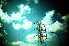 lines of power (poopoorama) Tags: light sky film tag3 taggedout clouds washington lomo lca xpro tag2 tag1 post kodak crossprocess towel wires kirkland e100vs letsplaytag theworldthroughmyeyes