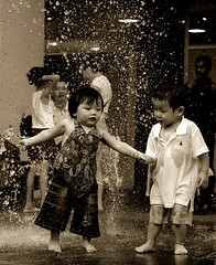 Chivalry? (... Arjun) Tags: boy bw 15fav water fountain girl monochrome sepia 1025fav 510fav movement nikon bravo singapore asia emotion d70s 2006 1870mmf3545g 2550fav 500v50f 50100fav 1000v100f tinted courtesy bugis loyalty politeness chivalry gallantry goodmanners 85points mireasrealm 100p 100200fav courtliness graciousness mireasrealmhalloffame anawesomeshot