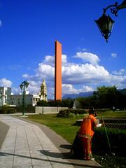two orange (u_p (un.titled_photo)) Tags: blue sky orange azul clouds mexico gente cielo nubes nuevoleon urbano naranja monterrey limpiando farodecomercio macroplaza