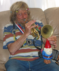 ...and plays him a tune. (Swankster) Tags: california gnome july4 hermosabeach