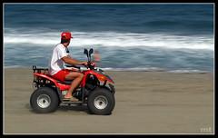 Barrido (manolotoledo) Tags: sea portrait espaa beach azul digital mar movement spain sand mt action playa olympus quad arena toledo manolo panning zuiko ola e500 barrido zd olympuse500 40150mm espacionegativo odelot manolotoledo