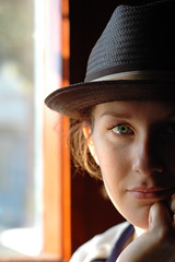 Hat (ilmungo) Tags: sanfrancisco california light shadow portrait woman eye girl beautiful face hat bar carolyn greeneyes wife thepage 50mmf18af