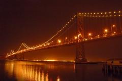 Bay Bridge (Nick Nick1) Tags: ocean sf sanfrancisco longexposure bridge water night reflections d50 lights bay interestingness nikon exposure nightimages nikond50 baybridge interestingness8406271